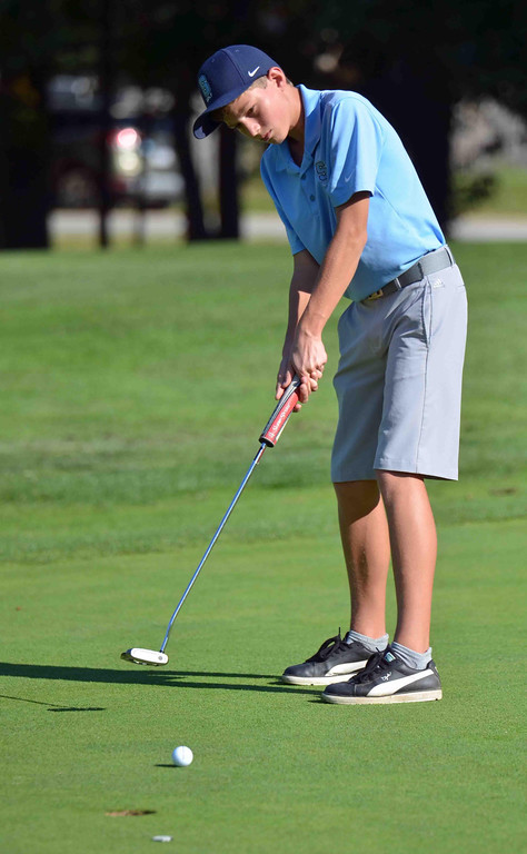 . Paul DiCicco - The News-Herald South Sophomore, Nelson Pike, follows through on a putt attempt at Manikiki Golf Course on Sept 21.