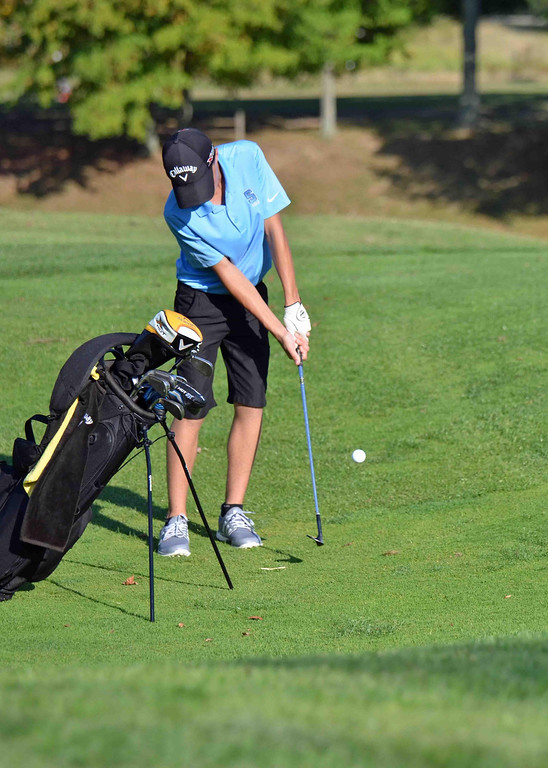 . Paul DiCicco - The News-Herald South Junior, Adam Paris, chips to within a few inches of the hole on the par 3 at Manikiki Golf Course on Sept 21.