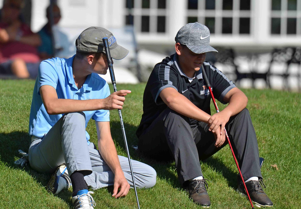 . Paul DiCicco - The News-Herald A North and South player discuss the match prior to their tee time at Manikiki Golf Course on Sept 21.
