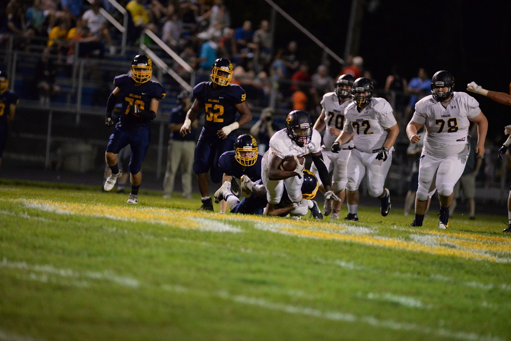 . Aimee Bielozer - The Morning Journal<br> North Ridgeville\'s Shomari Williams tries to fight his way through a tackle against Olmsted Falls on Sept. 22.