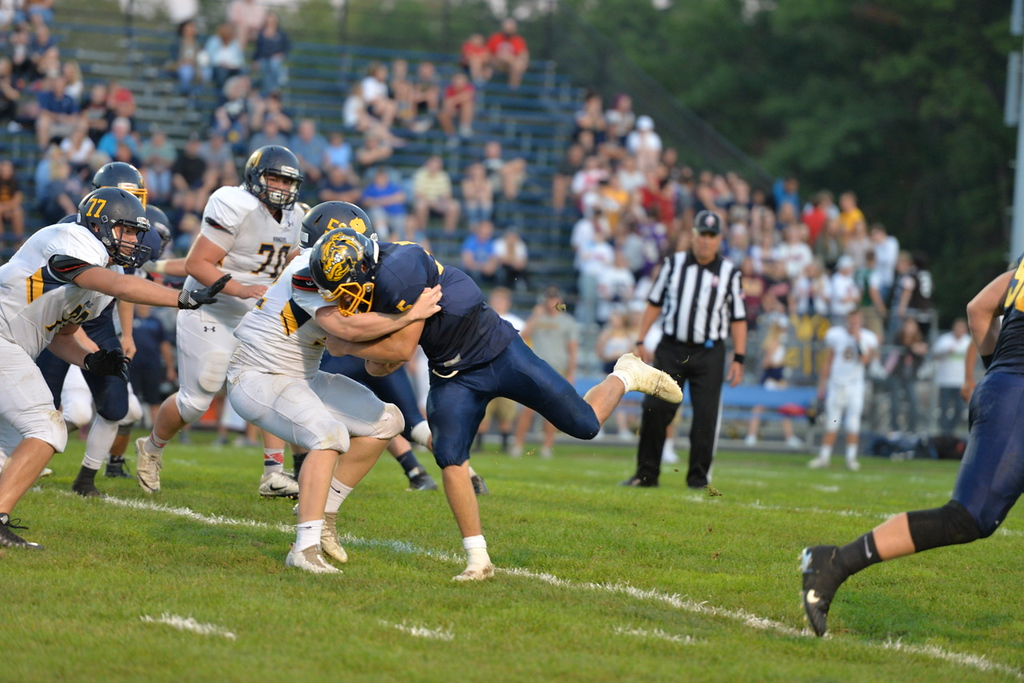. Aimee Bielozer - The Morning Journal<br> Olmsted Falls\' Luke Lombardo get tackled on Sept. 22.