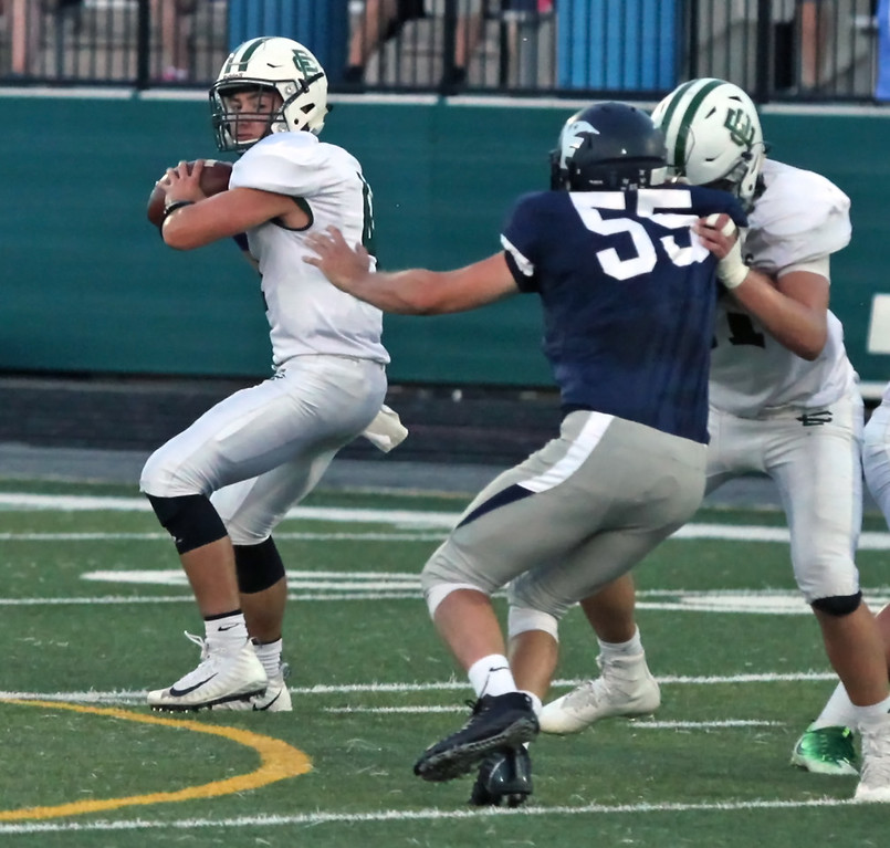 . Randy Meyers - The Morning Journal<br> Elyria Catholic quarterback Cameron Engrish looks to throw downfield as a Valley Forge defender is blocked by the offensive line on Sept. 21.