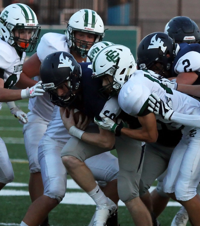 . Randy Meyers - The Morning Journal<br> Valley Forge quarterback John Quinones is swarmed by the Elyria Catholic defense as he fights for yardage during the first quarter on Sept. 21.