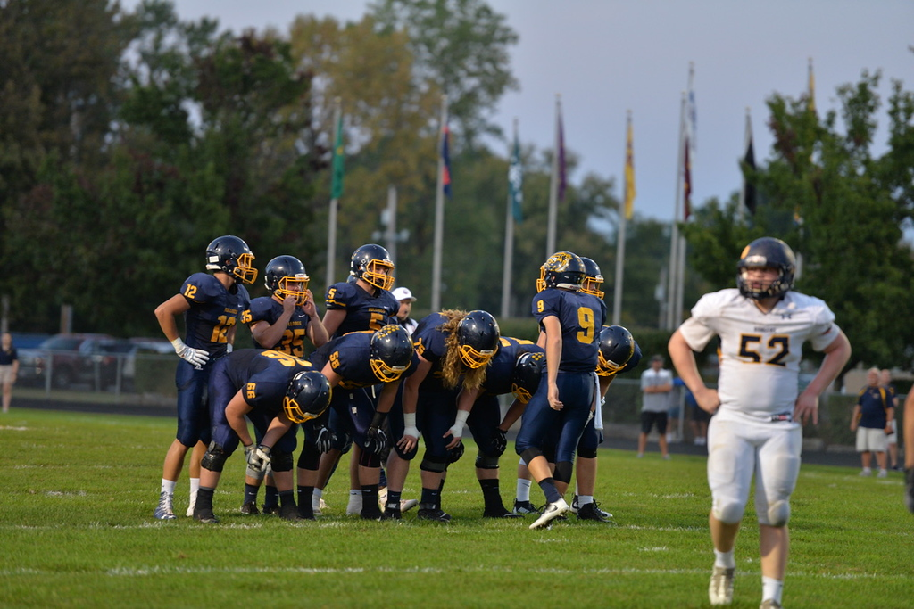 . Aimee Bielozer - The Morning Journal<br> Olmsted Falls quarterback Teddy Grendzynski play call against North Ridgeville on Sept. 22.
