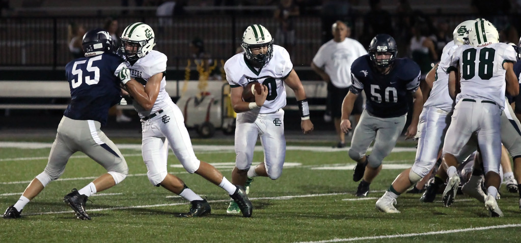. Randy Meyers - The Morning Journal<br> Leighton Banjoff of Elyria Catholic runs for a big gain through a huge hole in the Valley Forge defense on Sept. 21.