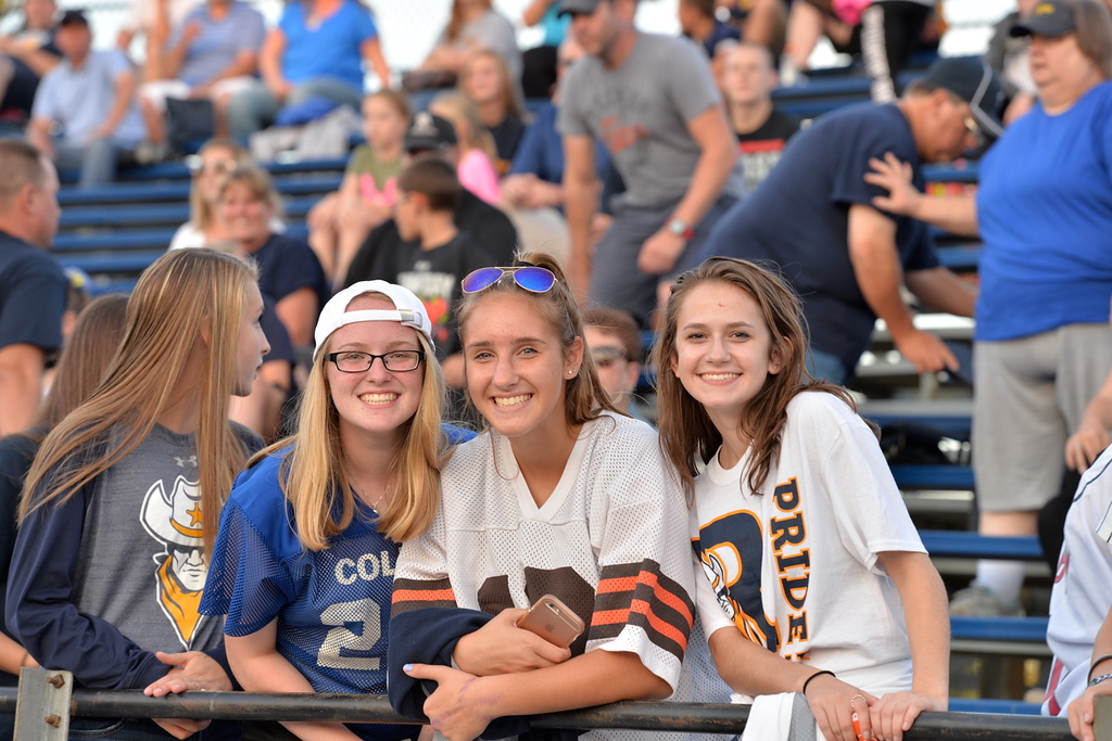 . Aimee Bielozer - The Morning Journal<br> North Ridgeville fans take a moment to smile for the camera on Sept. 22.
