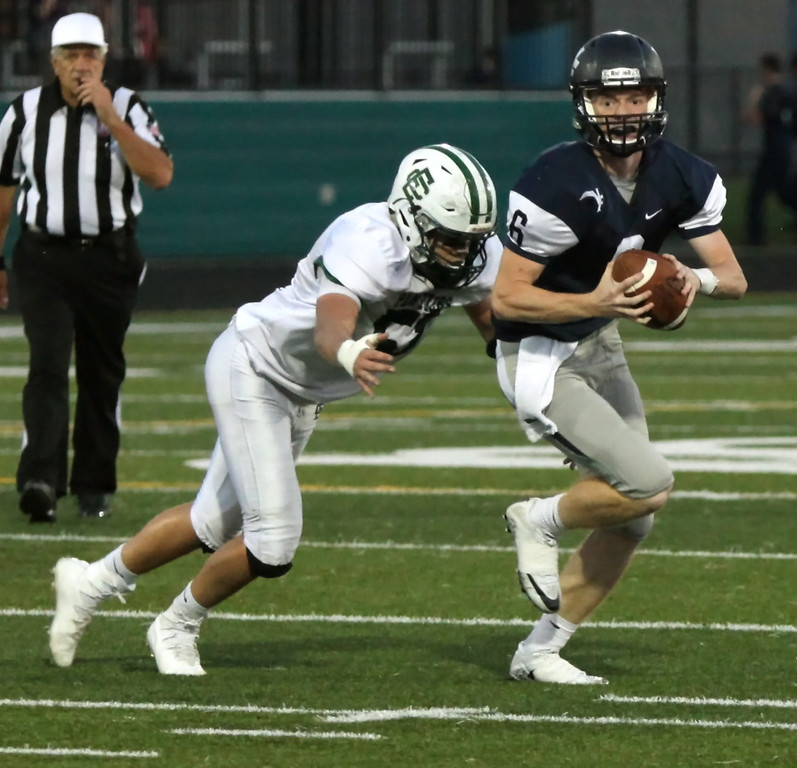 . Randy Meyers - The Morning Journal<br> Elyria Catholic\'s Griffin Davies closes in on Valley Forge quarterback John Quinones and makes a sack during the first quarter on Sept. 21.