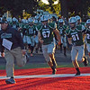 Paul DiCicco - The News-Herald<br /> Lake Catholic coach Scott  O'Donnell leading the Cougars onto the field against Cardinal Mooney on Sept. 24 at Jerome T. Osborne Sr. Stadium.
