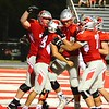 Brittany Chay - The News-Herald\<br /> Mentor players celebrate during their win over Shaker Heights.