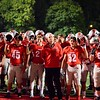 Brittany Chay - The News-Herald<br /> Mentor players sing their school's alma mater after defeating Shaker Heights.