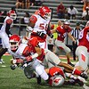 Brittany Chay - The News-Herald<br /> Mentor's Michael Ballentine makes a tackle vs. Shaker Heights.