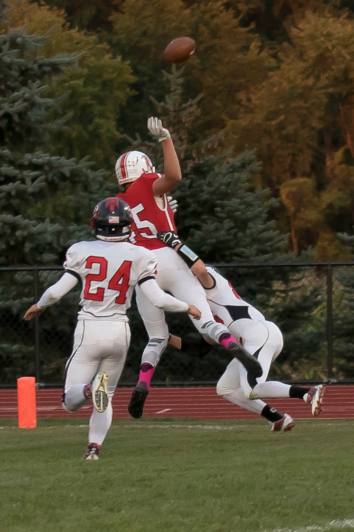 . Jen Forbus - The Morning Journal<br> Firelands reciever Richard Maggard (45) is denied a reception by Brookside\'s defensive back, David Chambers (86), with help from Cayden Gainer (24) on Sept. 29.