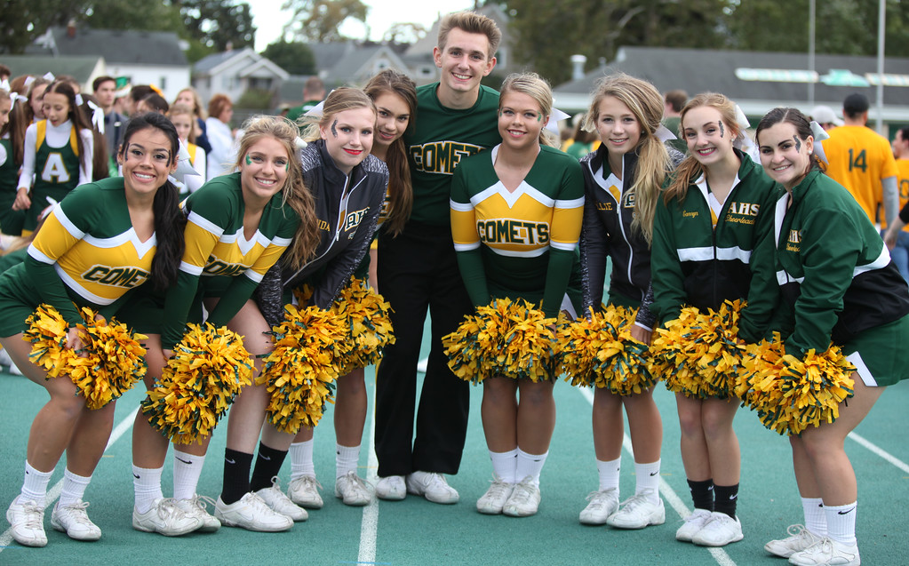 . Randy Meyers - The Morning Journal<br> Amherst Steele varsity cheerleaders pose for a photo prior to Friday\'s game against Olmsted Falls.