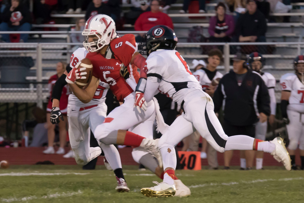 . Jen Forbus - The Morning Journal<br> Brookside\'s David Chambers (86) tries to slow down Firelands quarterback Blake Ruffner (5) as he plows forward for yardage on Sept. 29.