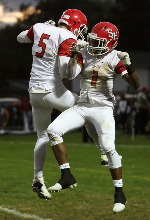 . Randy Meyers - The Morning Journal<br> Shaker Heights\' William Dunn Jr. celebrates with Micah Hills after a second quarter touchdown against Elyria Sept. 28.