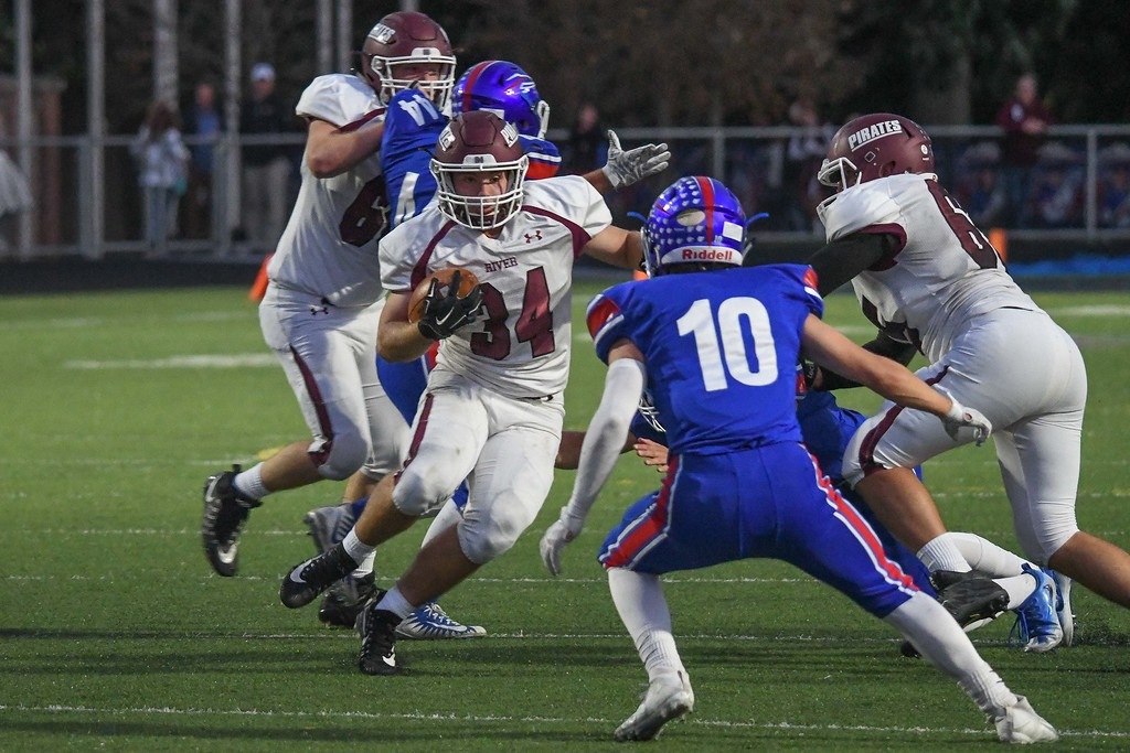 . Eric Bonzar�The Morning Journal <br>  Rocky River\'s Matthew Popovich (34) eyes up Bay defender Dillon Barry (10), Sept. 29, 2017.