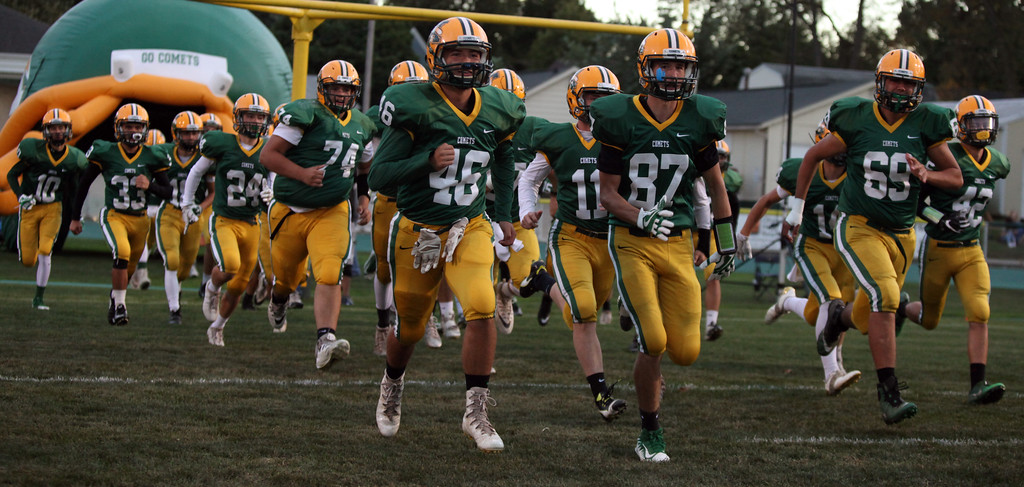 . Randy Meyers - The Morning Journal<br> The Amherst Comets football team takes the field against the Olmsted Falls Bulldogs on Sept. 29.