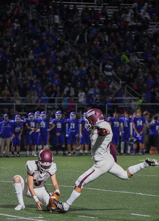 . Eric Bonzar�The Morning Journal <br>  Kicker Michael Konrad puts the Rocky River Pirates on the board with a field goal, Sept. 29, 2017.