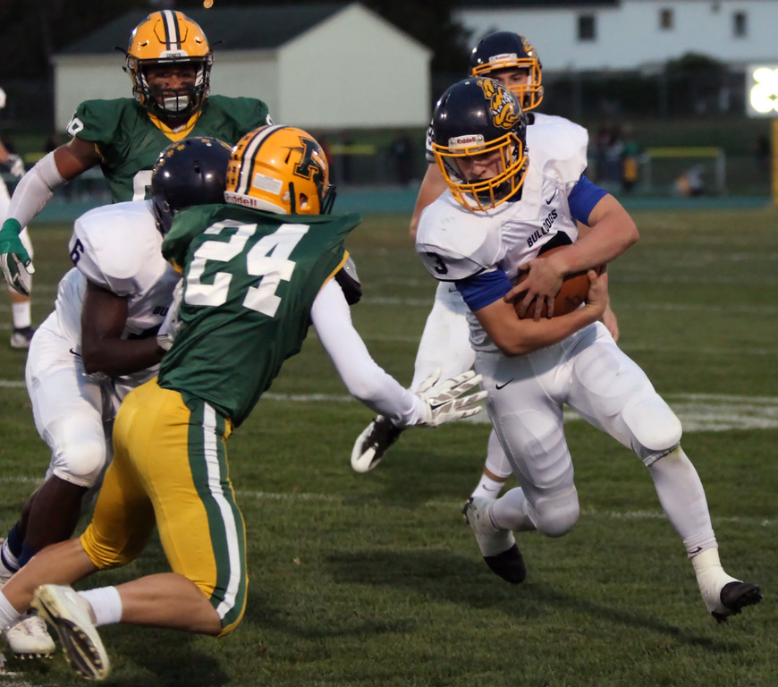 . Randy Meyers - The Morning Journal<br> Nick Daily of Olmsted Falls tries to turn the corner against Kyle Ferguson of Amherst during the first quarter on Sept. 29.