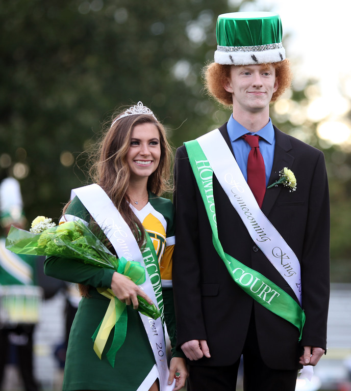 . Randy Meyers - The Morning Journal<br> Amherst Homecoming King PierceBarnes and Homecoming Queen Jenna Moore pose for photos prior to Friday\'s game against Olmsted Falls.