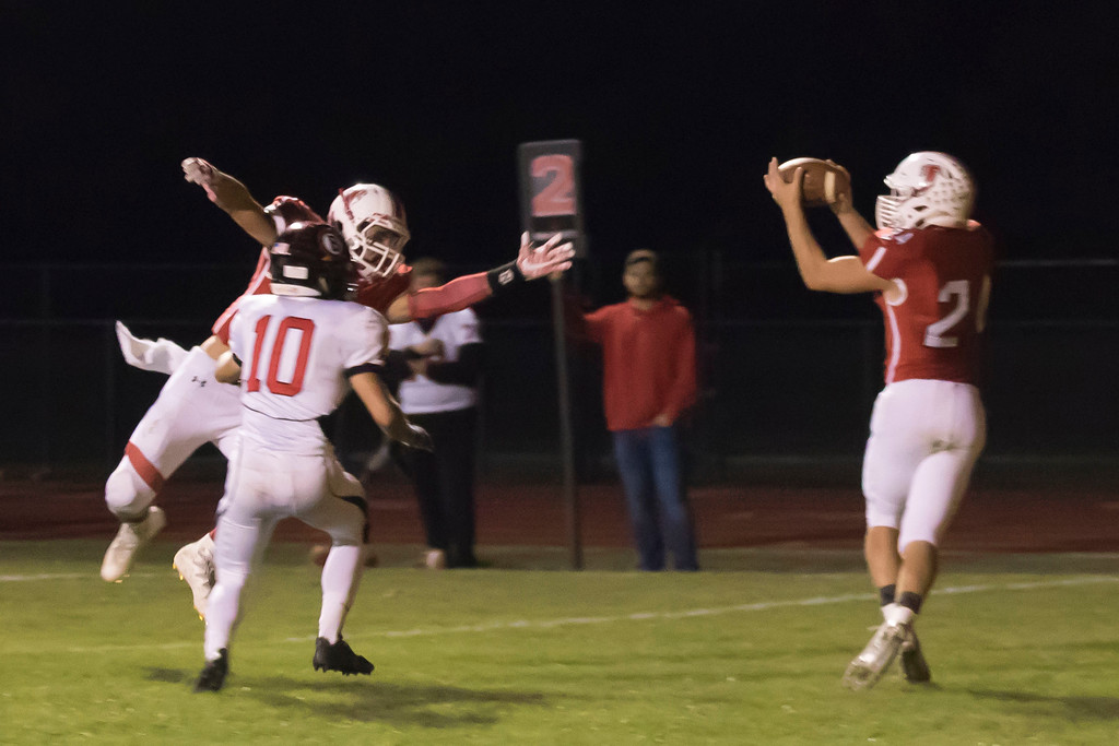 . Jen Forbus - The Morning Journal<br> A completed pass to Firelands receiver Cayden Gainer (24) results in a touchdown against Brookside on Sept. 29.
