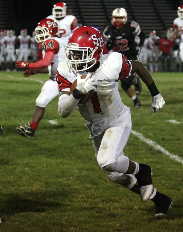 . Randy Meyers - The Morning Journal<br> Micah Hills of Shaker Heights scores a second touchdown against the Elyria defense on Sept. 28.
