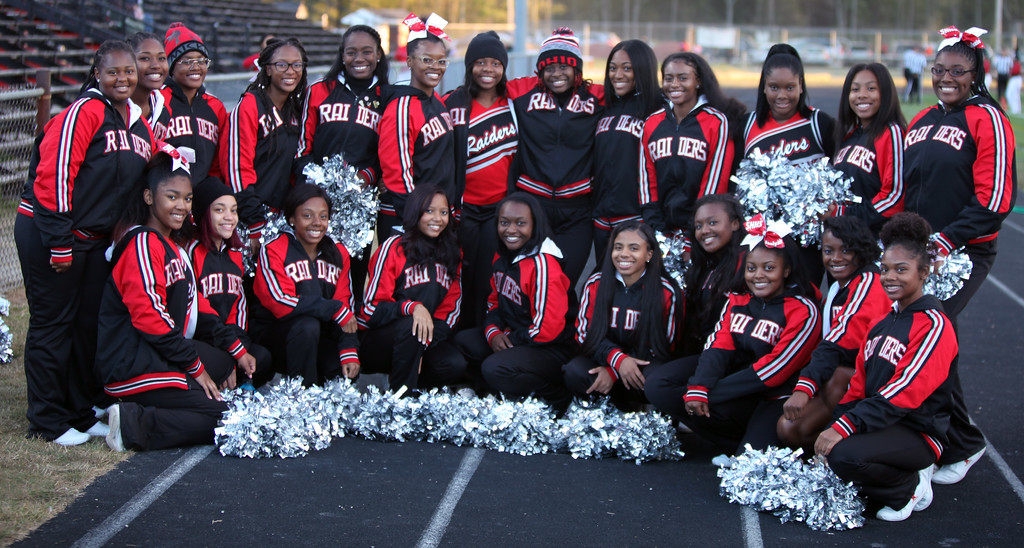 . Randy Meyers - The Morning Journal<br> Shaker Heights\' cheerleaders pose for a photo prior to Thursday\'s game against Elyria.