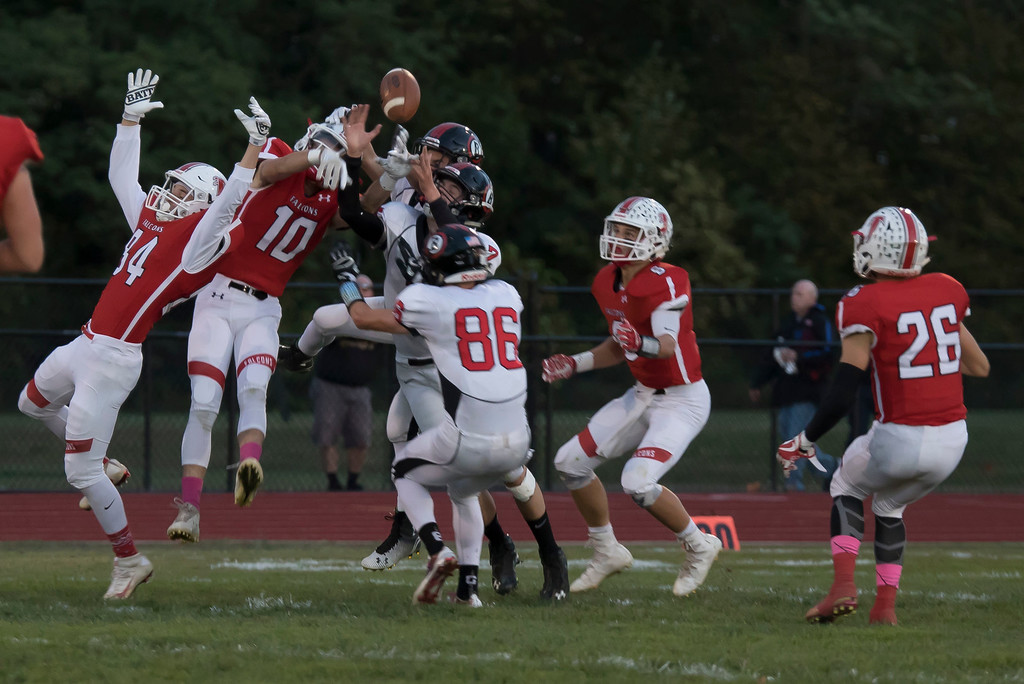 . Jen Forbus - The Morning Journal<br> A pass intended for Brookside receivers is broken up by Firelands safety, Matthew Kovach (10), on Sept. 29.