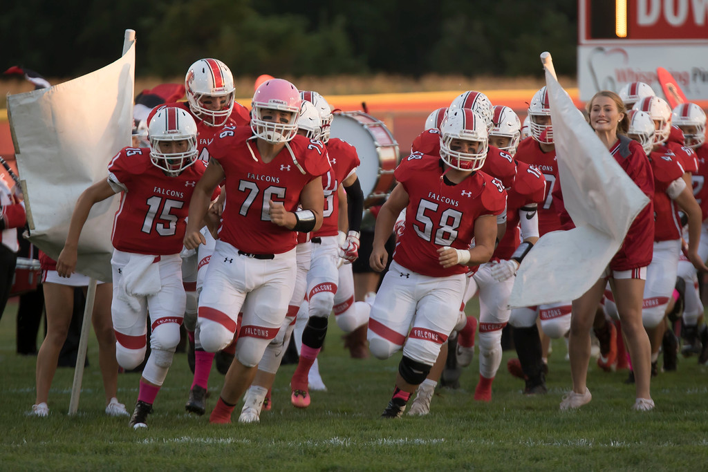 . Jen Forbus - The Morning Journal<br> Firelands\' Jacob Farley (15), Tyler Bennett (76) and Landon Peterson (58) lead the squad onto the field against Brookside on Sept. 29.
