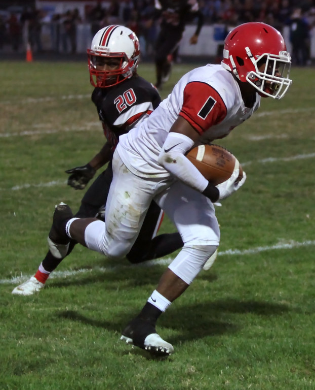 . Randy Meyers - The Morning Journal<br> Micah Hills of Shaker Heights runs by Ty\'Jhon Allgood of Elyria and scores the touchdown during the second quarter on Sept. 28.