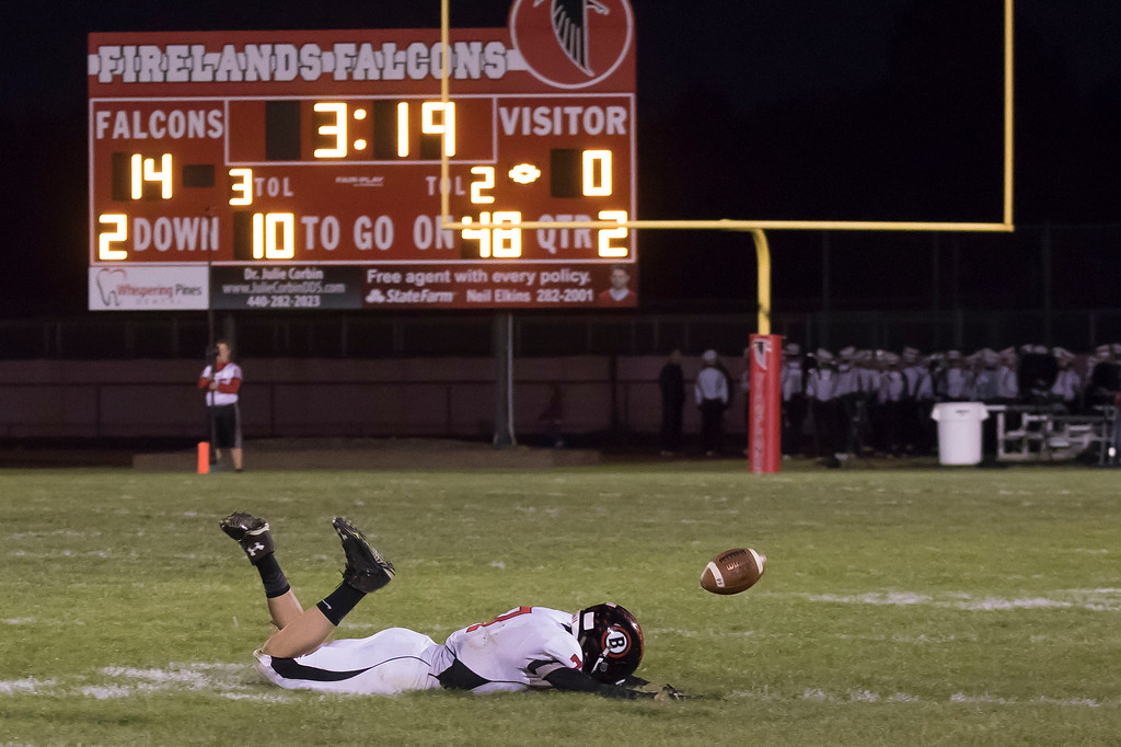 . Jen Forbus - The Morning Journal<br> Brookside\'s Eric Fabanich (7) can\'t haul in a pass in spite of a diving attempt against Firelands on Sept. 29.
