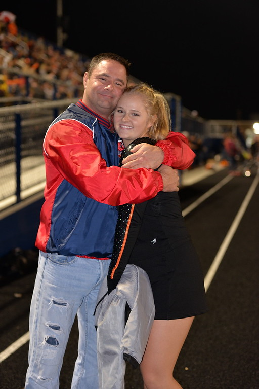 . Aimee Bielozer - The Morning Journal<br> North Olmsted cheerleader Madison Nester gets a hug from her father, Jim.