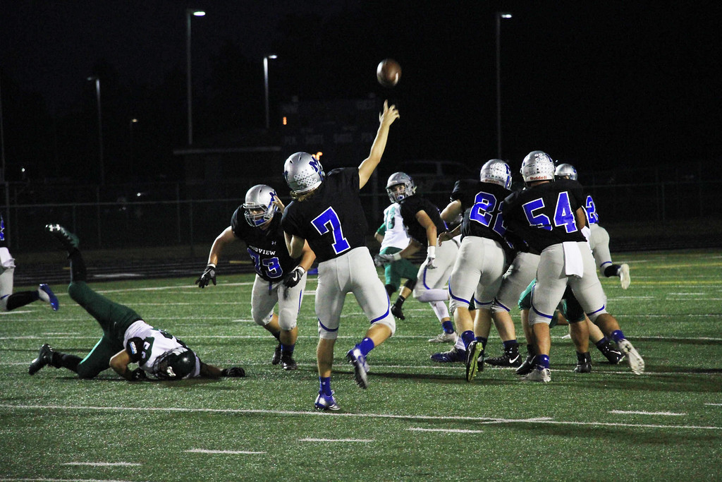 . Nicholas Pfeifer - The Morning Journal<br> Midveiw quarterback Seamus Higley delivers a strike downfield for a Middies touchdown in the second quarter agaisnt Westlake on Oct. 6.