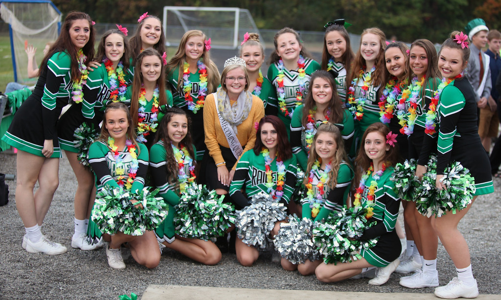 . Randy Meyers - The Morning Journal<br> Columbia varsity and junior varsity cheerleaders pose for a photo along with the Homecoming Queen Cassi Zeinert prior to Friday\'a game against Clearview.