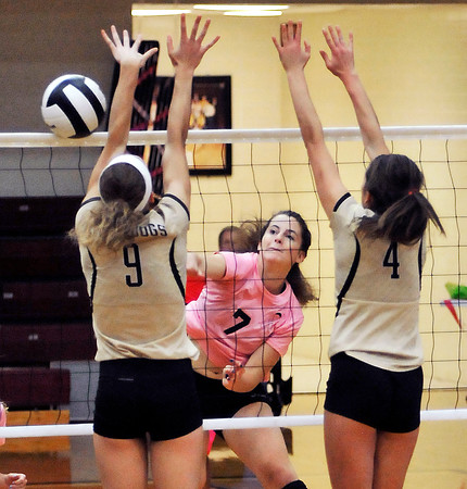 John P. Cleary | The Herald Bulletin<br /> Alexandria's Blaine Kelly goes for the a kill as Lapel's Taylor Murdock and Macie Schmitt try to block.