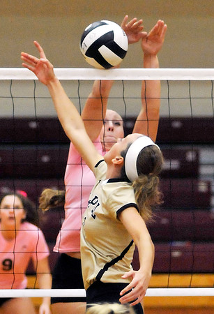 John P. Cleary | The Herald Bulletin<br /> Lapel's Makynlee Taylor tries to tip the ball over the net as Alexandria's Mackenzie McCarty  goes for the block.