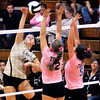 John P. Cleary | The Herald Bulletin<br /> Lapel's Emily Eppert goes for the kill as Alexandria's Mackenzie McCarty and Madalyn Weaver defend.