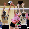 John P. Cleary | The Herald Bulletin<br /> Alexandria's Blaine Kelly goes for a kill as Lapel's Taylor Murdock and Isabel Anderson try to block.