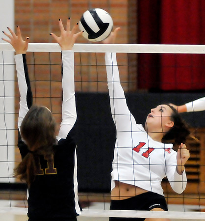 John P. Cleary | The Herald Bulletin<br /> Frankton's Ryann Shively hits the ball over the net as Alexandria's Allyson Granger tries to block the shot.