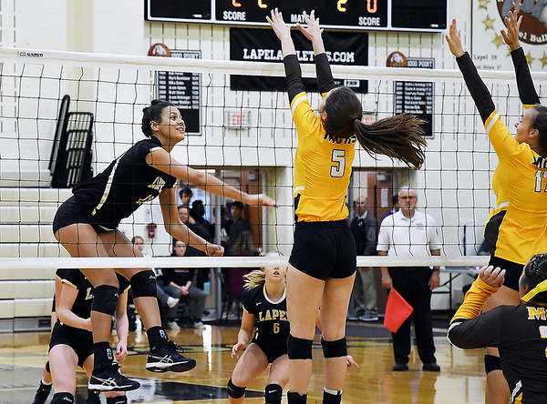 John P. Cleary | The Herald Bulletin<br /> Lapel's Makynlee Taylor follows through on her kill that won the third set and the match against Monroe Central.