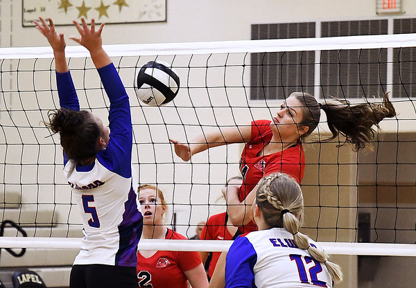 John P. Cleary | The Herald Bulletin<br /> Frankton's Chloee Thomas, right, takes a shot as Elwood's Macy Wilson defends the net. The shot was low and fell off the net.