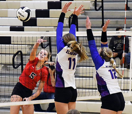 John P. Cleary | The Herald Bulletin<br /> Frankton's Kate Sperry spikes the ball past Elwood defenders.
