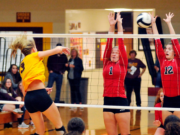 John P. Cleary | The Herald Bulletin<br /> Alexandria's Megan Miller gets one of her 15 kills hitting between Frankton's Anna Sperry and Gabby Carmack.