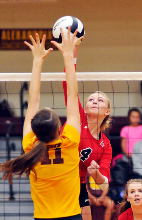 John P. Cleary | The Herald Bulletin<br />  Frankton's Audrey Cleek hits the ball over the arms of Alexandria's Allyson Granger.