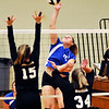 John P. Cleary |  The Herald Bulletin<br /> Elwood's Grace Rogers get one of her 16 kills against Sheridan.