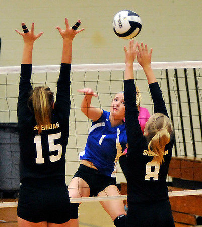 John P. Cleary |  The Herald Bulletin<br /> Elwood's Emily Booker returns the ball between two Sheridan defenders.