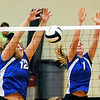 John P. Cleary |  The Herald Bulletin<br /> Elwood's Grace Rogers and Emily Booker protect the net with a block.