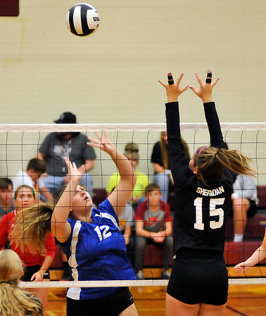 John P. Cleary |  The Herald Bulletin<br /> Elwood vs Sheridan in sectional volleyball.