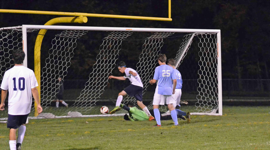 . Paul DiCicco - The News-Herald Wickliffe Junior, Nick Telisman, pushes past the goalie for a rebound score early in the first half on Oct 12.