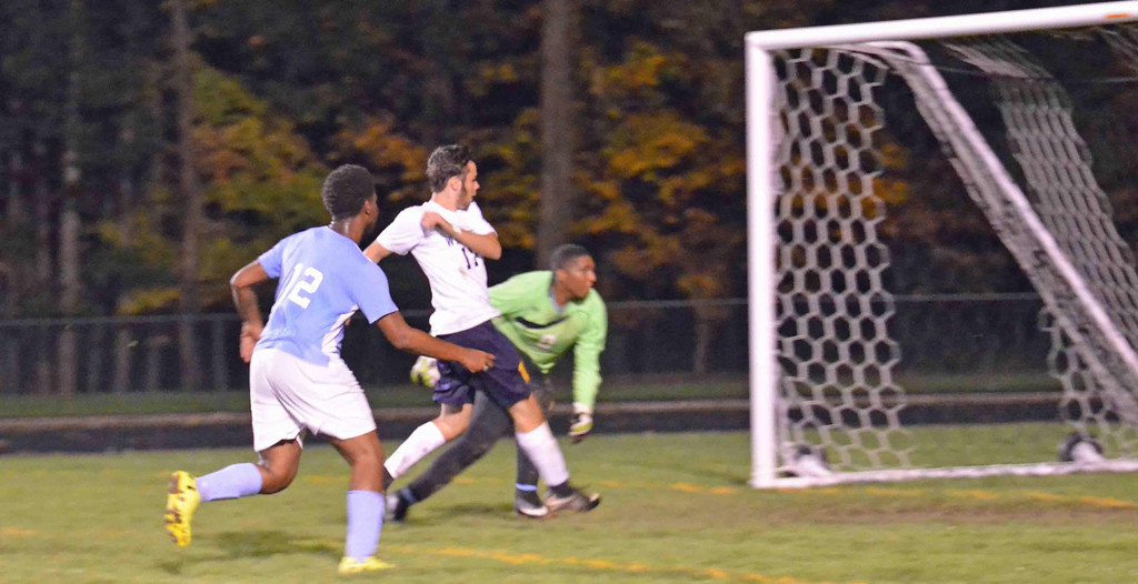 . Paul DiCicco - The News-Herald Wickliffe Junior, Jonny Abramczyk, flies through the middle to scorer the fourth goal of the evening for Wickliffe on Oct 12.